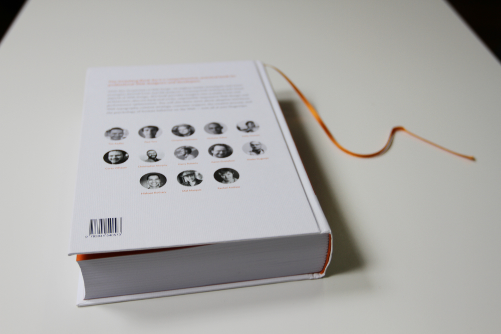 On the last cover there is a quick presentation of the book and all the authors featured. Also, the book comes with an orange thin, slick bookmark strap.