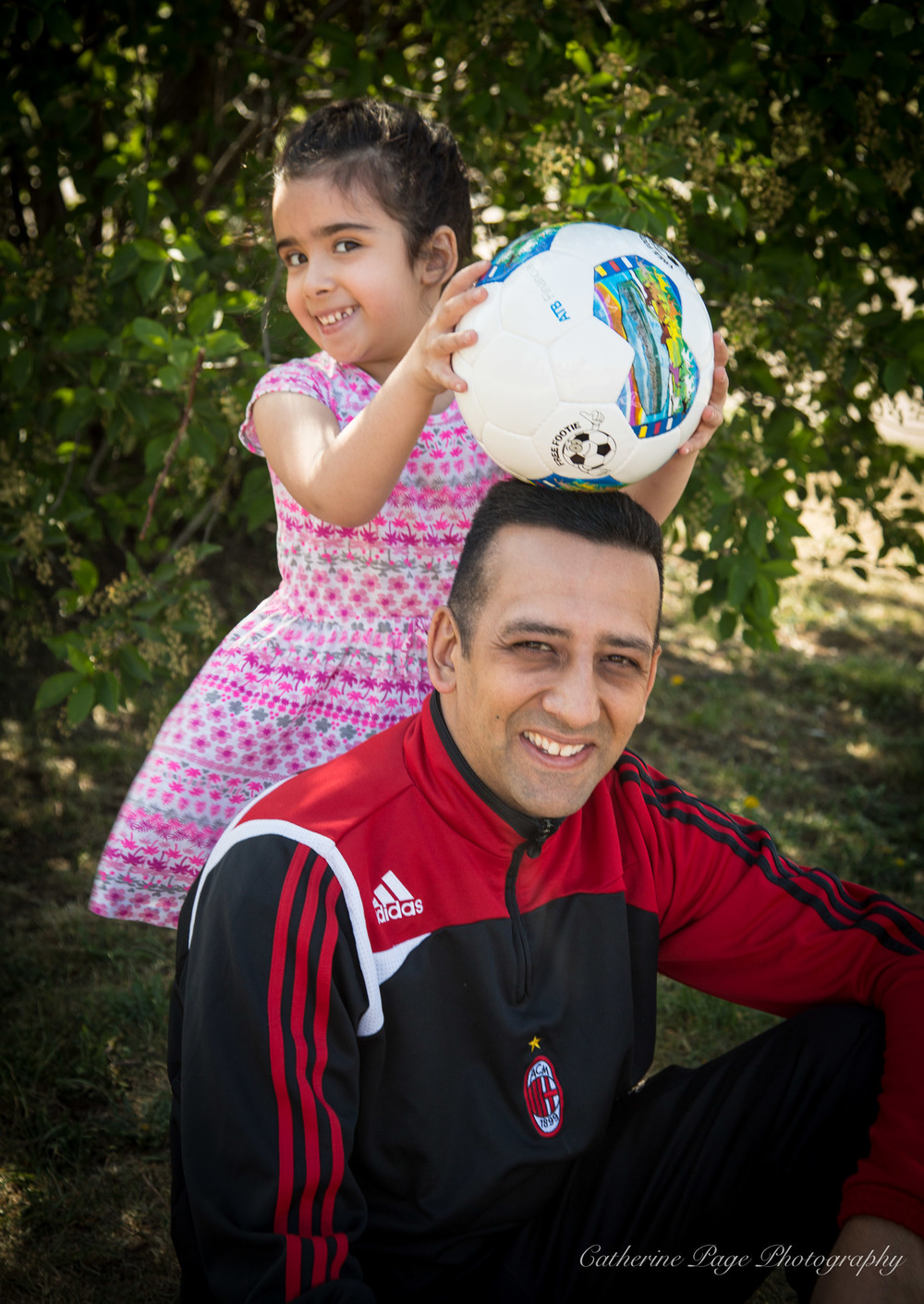 Andrew and his daughter. Footie runs in the family :)
