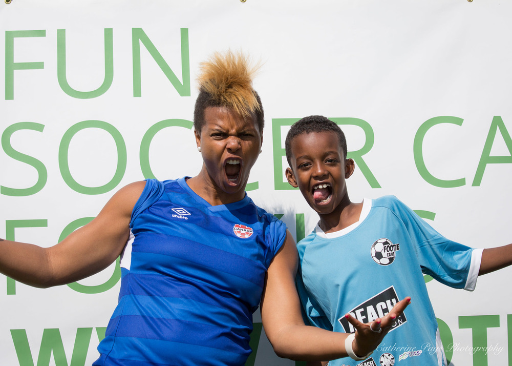 Reach Edmonton is helping support Footie Camp this July! It's our first ever summer soccer camp and allows us to extend the league we run during the school years. Featured in this photo are Karina LeBlanc, the former goal keeper of the Canadian Women's National Soccer Team, and one of our awesome athletes.