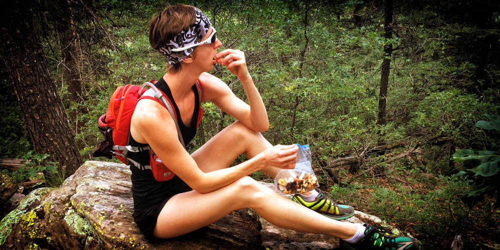 Jennifer Grantham eating trail mix on the Colorado Trail