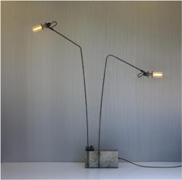 """A New Twist on a Dense Subject""  - In a feature piece about Joshua Howe's lighting units Tim McKeough writes, ""Joshua Howe, 36, a designer in Chatham, N.Y., who has worked with concrete for five years, sees beyond its limitations.""   New York Times."