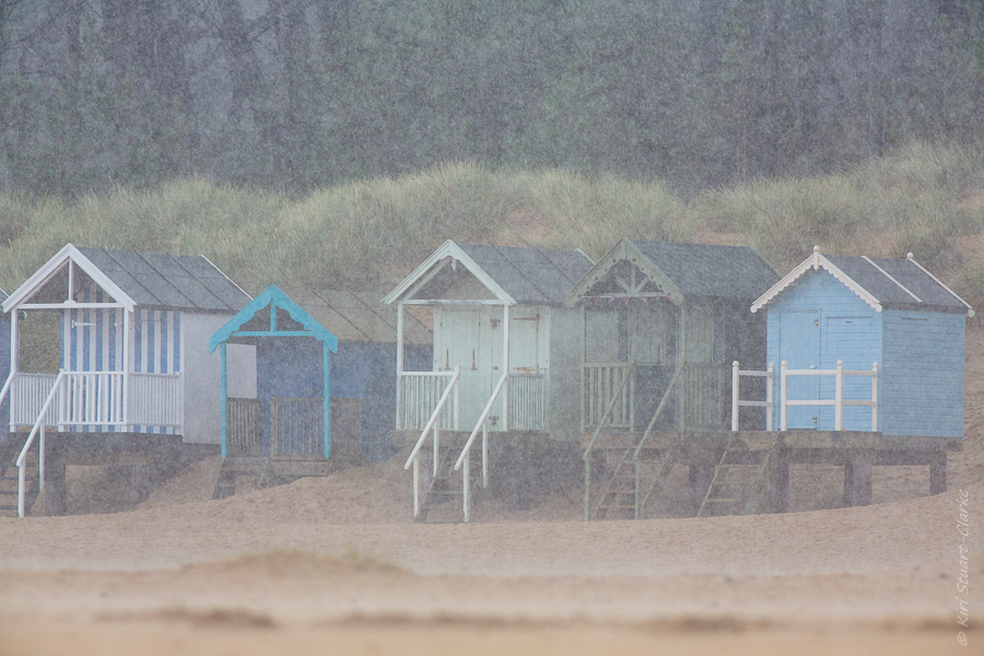 Beach huts in hail storm