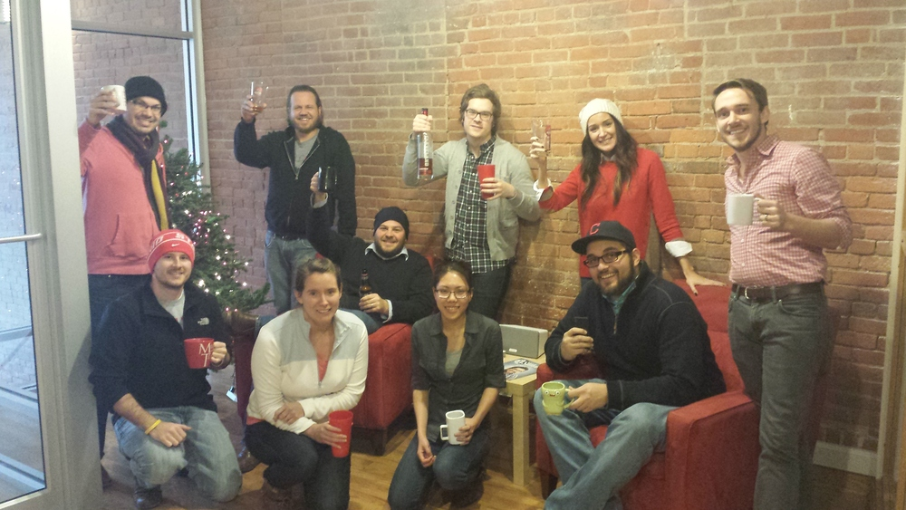 The Recess Team posing by the tree with some Cleveland Whiskey.