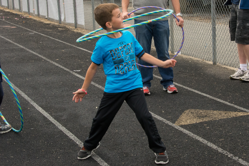 What skill..hula hoop around the neck!