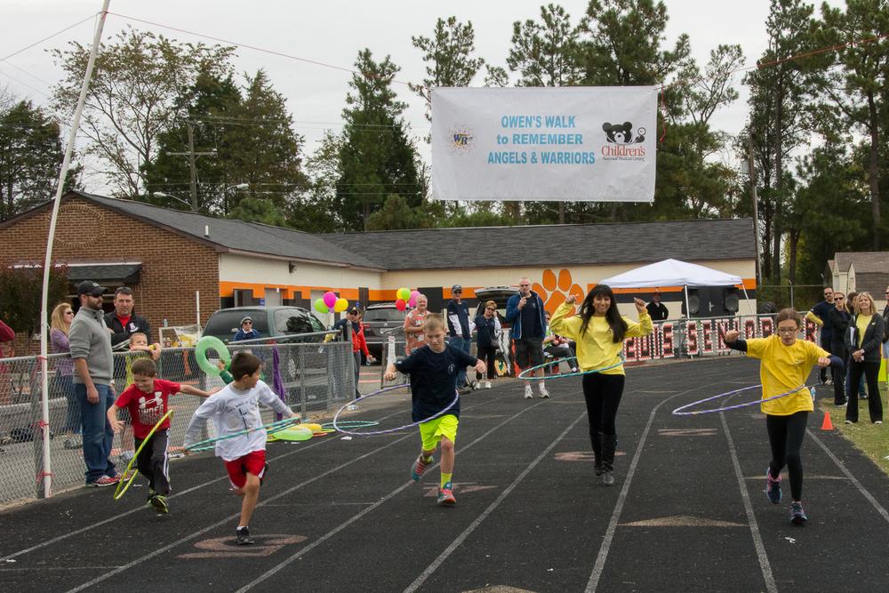 Wacky Relay Race…1st group…run with a hula hoop