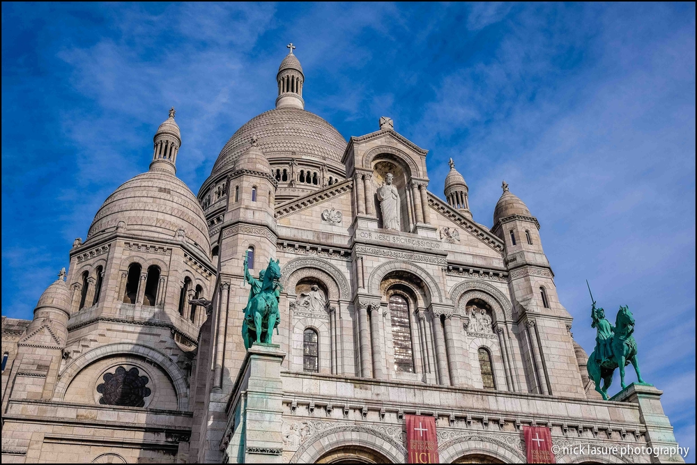 The Sacré Cœur in Paris' Montmartre neighborhood overlooks the city from above // Fuji X-T1