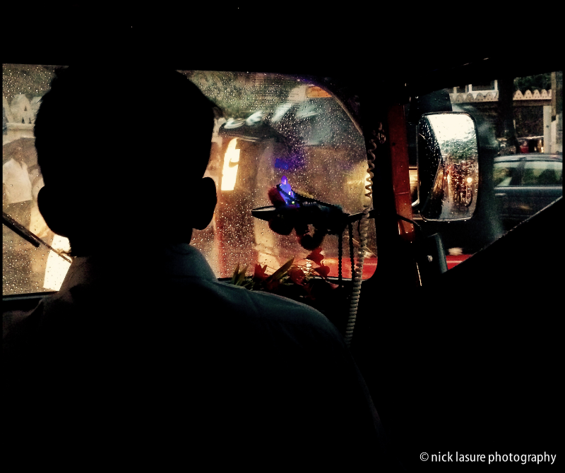 Braving the rain slicked roads in the Sri Lankan mountain town of Kandy in a tuk-tuk as the driver's Buddha glows // iPhone 5S