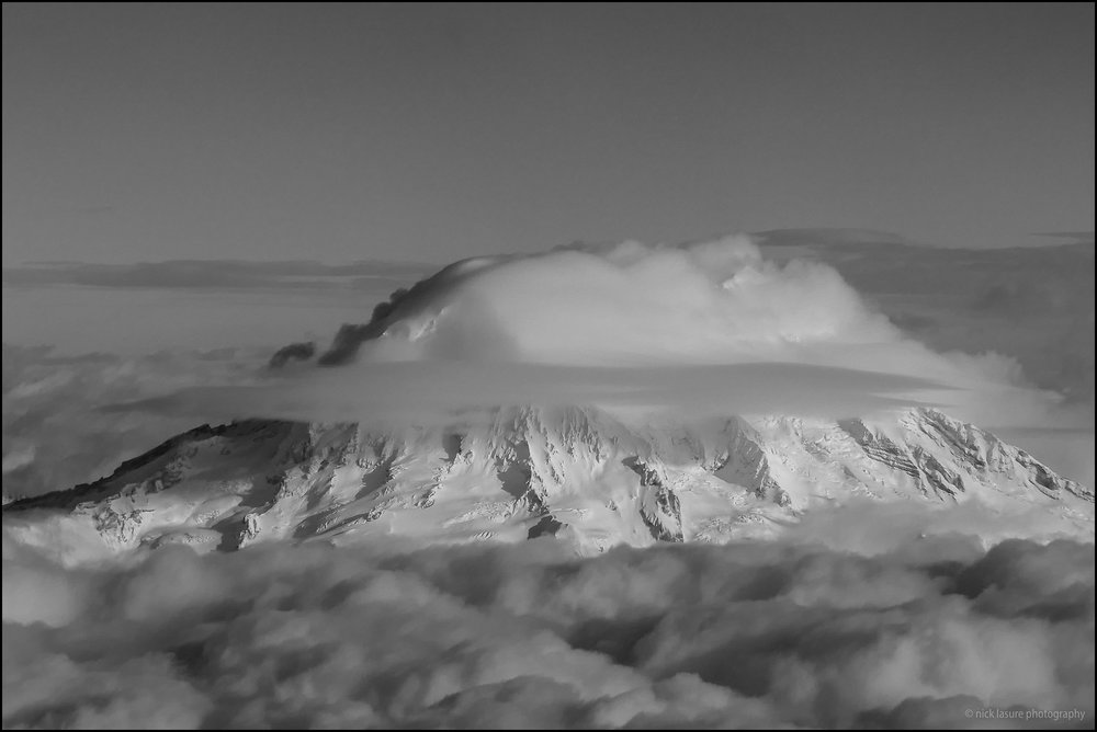Mt. Rainier looking formidable above the clouds. I believe big zooms on compact cameras are in the gimmicky range but occasionally they are useful.