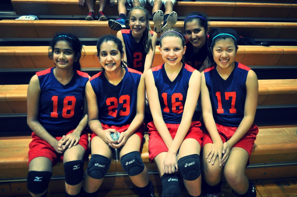 8th grade volleyball players (left to right) Apoorva C., Krishna V., Ally K., Miranda B., Mayu G., and Kaitlin O. were taught the value of team by Coach Nielson this season. Photo by Sanika