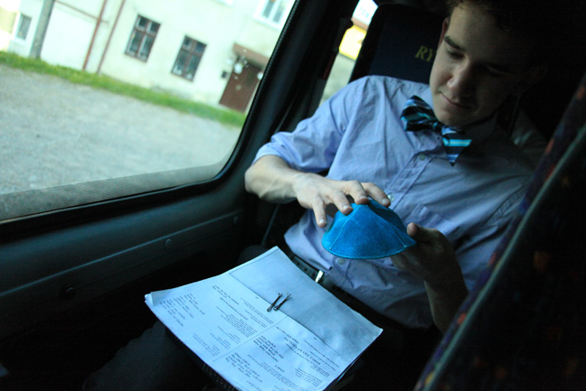 A student prepares and gathers his thoughts on the bus ride to the synagogue.