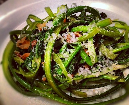 Garlic scapes, shaved into ribbons and stir fried with broccoli rabe.