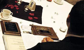 A member of Theta Chi sits with the awards his fraternity won last night at during the Greek Oscars - Photo Courtesy of The Daily Collegian