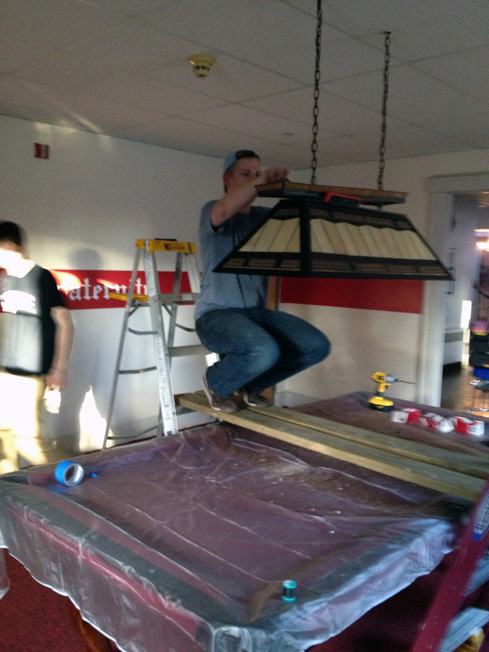 2013 Alumni Work Weekend - Pool Room Project Kevin Trippel installs the new pool light