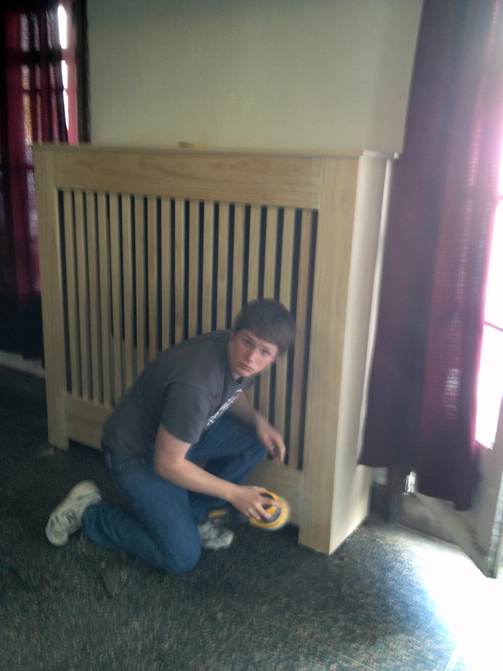 2013 Alumni Work Weekend - Pool Room Project Ian Maxwell puts the final touches on the new radiator covers