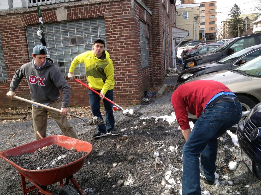 2013 Alumni Work Weekend - Pool Room Project Alejandro Buxo, Zach Meharey, Brad Mackey working on the parking lot