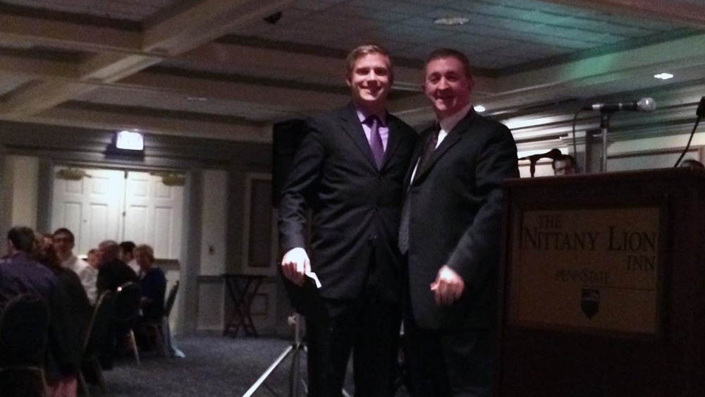 Kevin Trippel recieves his Theta Chi Citiation of Honor from Dr. Roy Baker - Theta Chi Gala - Oct. 21, 2013