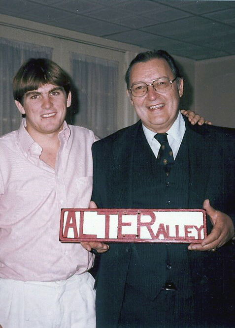 Mike Garrity (L) and Howard Alter Jr. - Br. Alter was honored at 1983 Homecoming celebration with the unoffical renaming of the alley behind the chapter house to Alter Alley - October 22, 1983