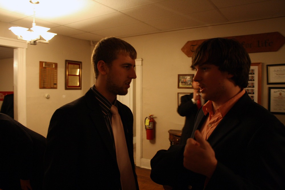 David Stoltzfus (L) conversing with little brother Sam Shively (R)