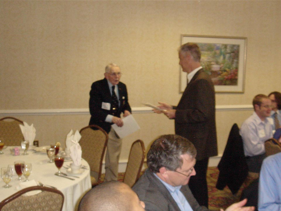 William Grun receives Golden Guard Award from Lindsay Olsen