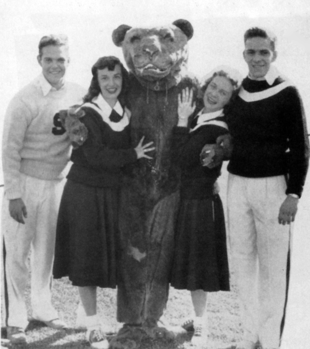 Alex Gregal (C) as the Nittany Lion and William Shomberg (far right)