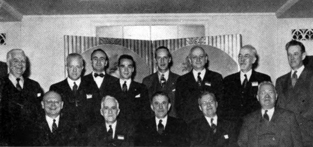 L. to r., front row: Maxwell E. MacDowell, Colgate, '14, National Board of Trustees; George Starr Lasher, Michigan, '11, editor The Rattle of Theta Chi; Frederick W. Leduc, Colgate, '12, national president; Earl D. Rhodes, Rensselaer, '21, National Board of Trustees; George V. Catuna, Rensselaer, '13, former national president; back row: James G. Lewis, Delaware, '12, former national vice president; Dr. Harold Browning, Rhode Island, '14, vice president and dean of students, Rhode Island State College; Dr. Robert W. Bishop, Cincinnati, executive secretary of Omicron Delta Kappa and secretary of the Association of Honor Societies; Stanton Belfour, Pittsburgh, national president Omicron Delta Kappa; George W. Chapman, Penn State, '20, national treasurer; Dean Cad Kallgren, Colgate, '17; Floyd Field, Georgia Tech, '02, dean of men, Georgia Tech; Francis H. S. Ede, Dickinson, '17, national secretary. Absent from the picture, Franklin W. Plummer, Indiana, '46, representing the Indiana University Interfraternity Council, and Col. Charles Ross Greening, Washing-ton State, '32, who is director of the Prisoners of War Exhibition - as appeared in The Rattle, Fall 1945