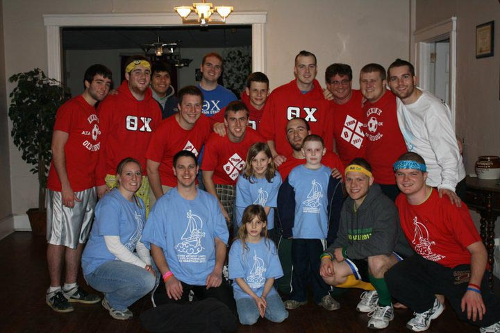 Omega Chapter brothers with the Bobby family