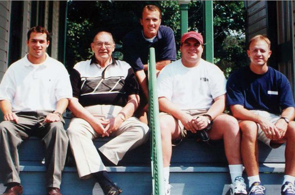 For many field men, stopping by Stockland Farm to see Howard had become an often anticipated tradition. From L–R: Ty Humpert (Theta Tau/Western Michigan '97), Howard, Mike James (Gamma Phi/Nebraska Wesleyan '96), Jeff Roberts (Delta Alpha/Linfield '97), and Randy Harrington (Gamma Phi/Nebraska Wesleyan '97)