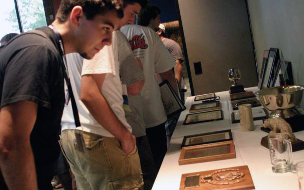 Brothers and guests check out all of Hoard Alter's awards and memento's at the summer Chapter Leadership Conference   held on the weekend of July 17, 2009.