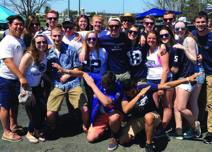 Brothers and friends gather for a tailgate at this year's Blue- White football game.