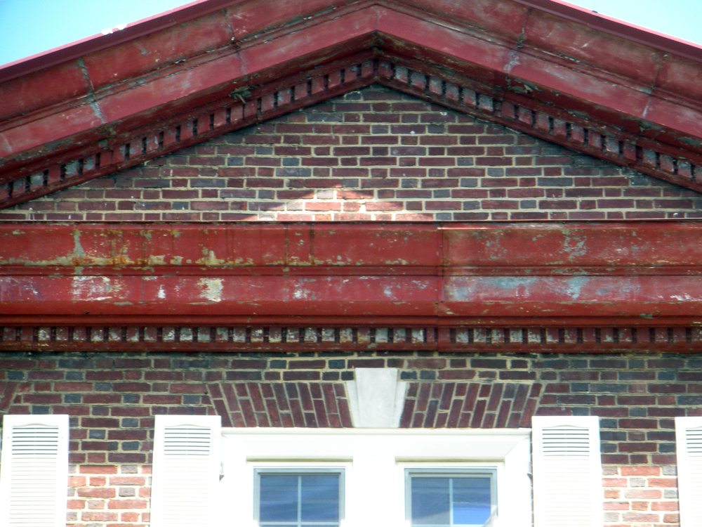 The remaining exterior trim has been repaired and painted, including the cornice work at the top of the house.