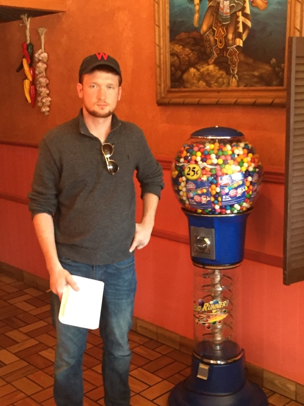 Rory McGowan stands tall next to his favorite gum ball machine - Fall 2017