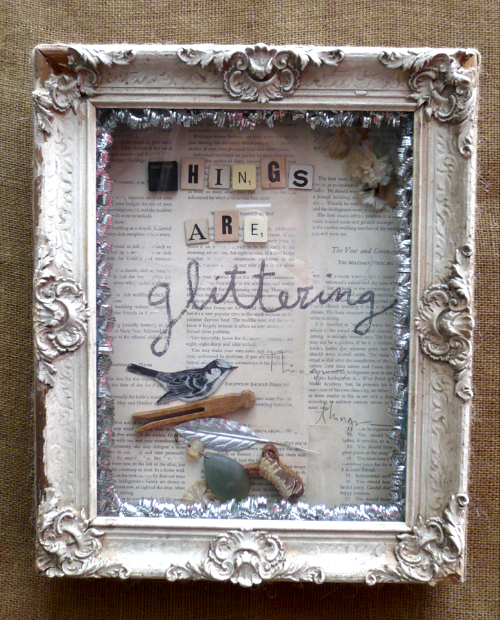 "2009  Mixed media and found objects in wood construction with vintage frame.  13"" x 16"""