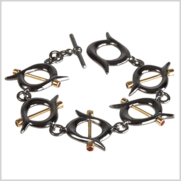 Firefly bracelet - £800  Silver plated in 18k gold and black rhodium and embellished with fire opals