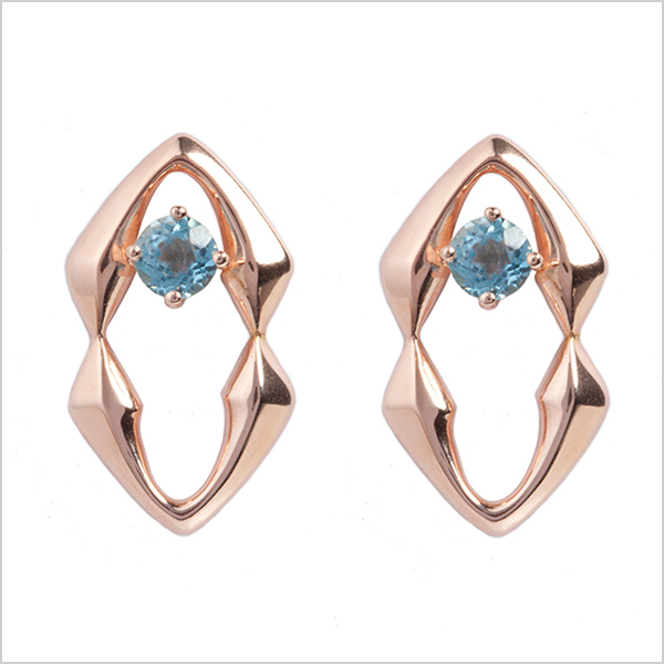 Hope studs - £225   Silver plated in rose gold and embellished with blue topaz gemstones