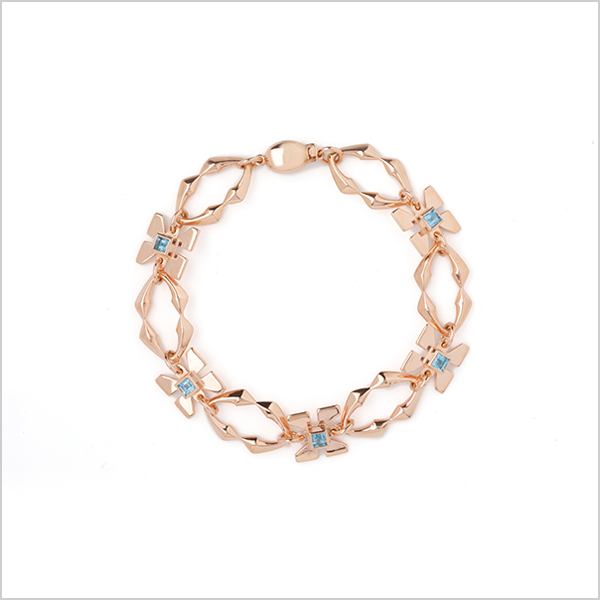 Hope Bracelet £625   Silver plated in rose gold and embellished with blue topaz gemstones