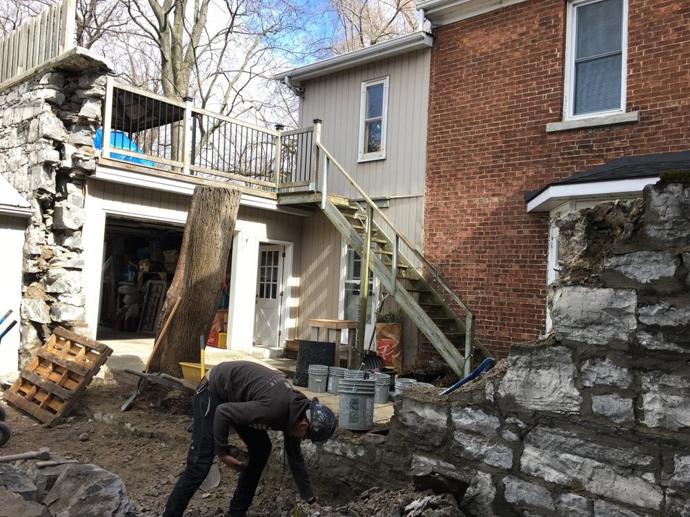 dismantle-of-limestone-wall