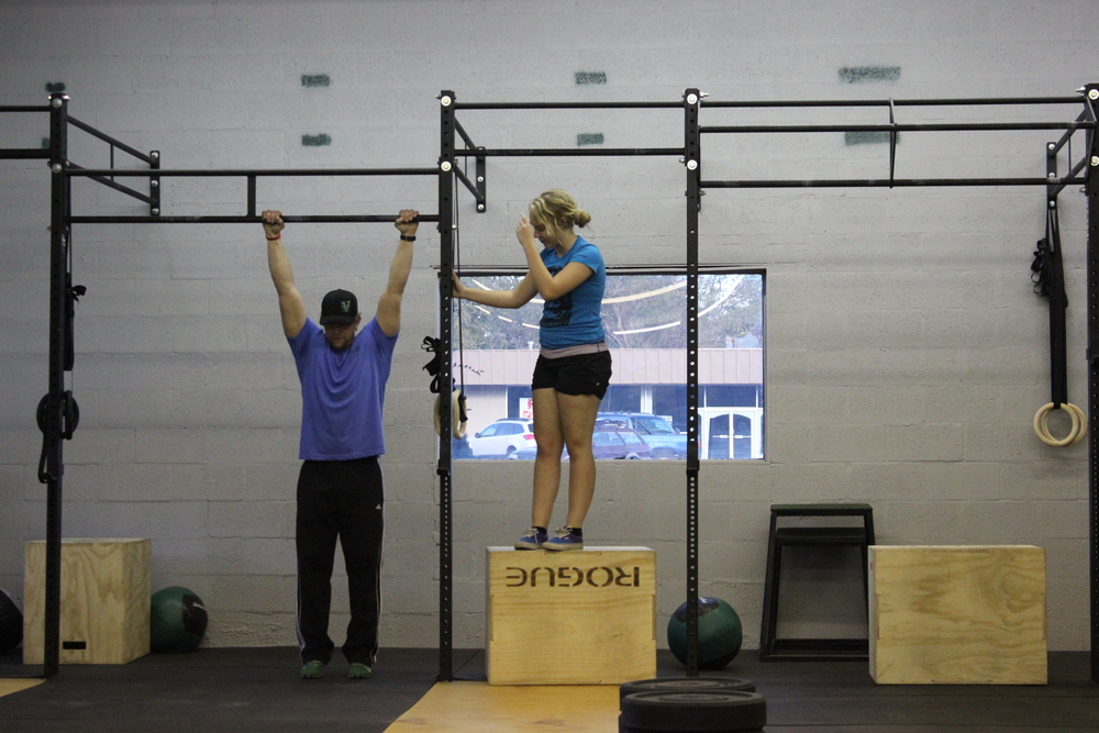 Learning toes to bar with Coach Liz Miller