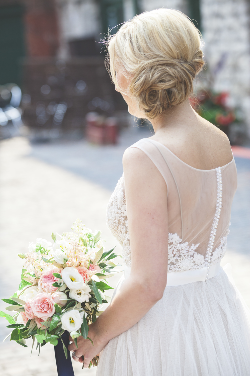 A beautiful wedding bouquet and dress photograph.