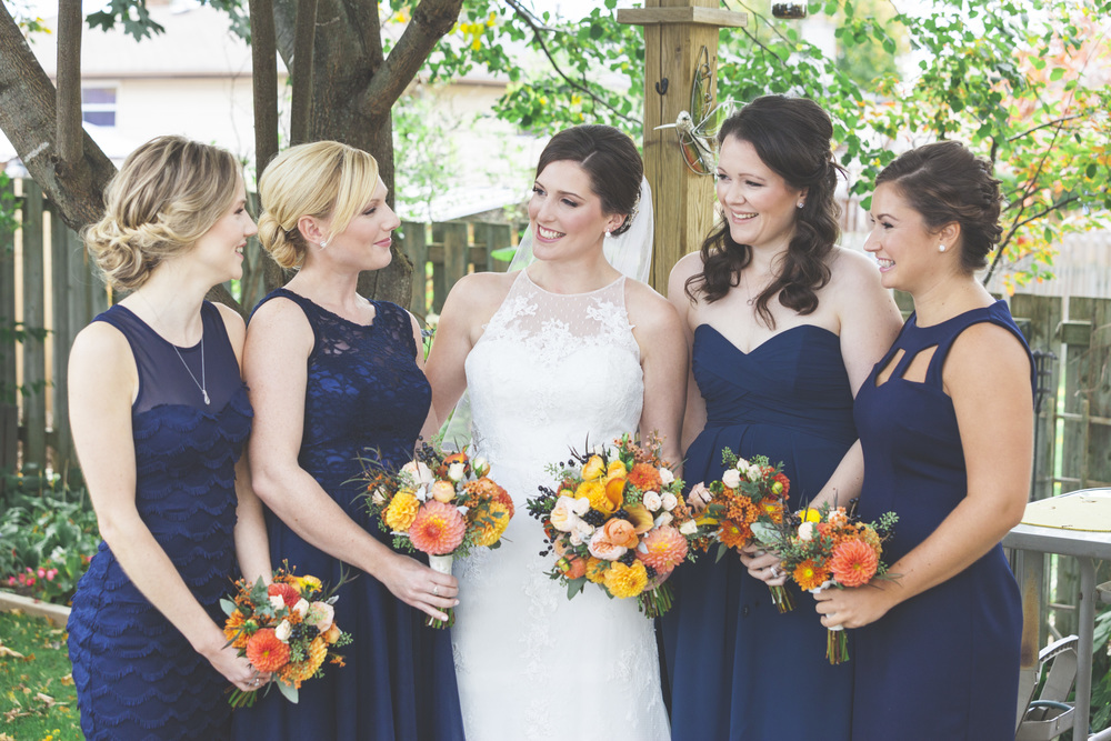 Backyard photo of the bride and bridesmaids.
