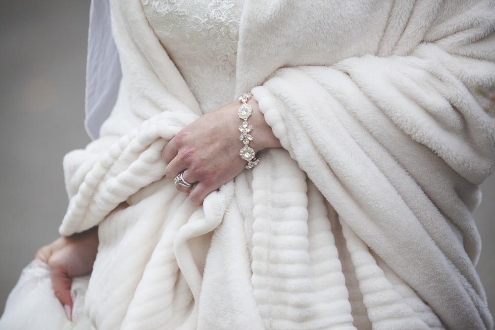The bride keeping warm.