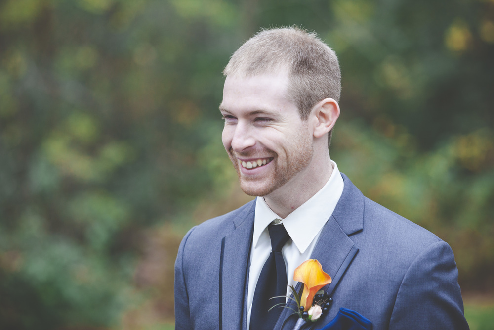 The groom is all smiles.