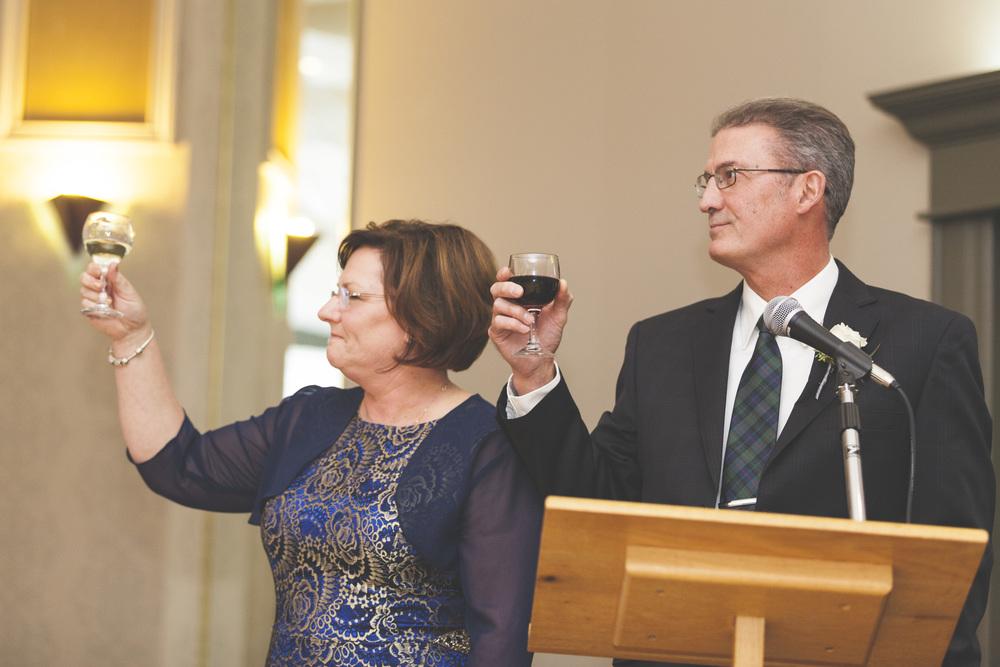 The proud parents raise a glass.