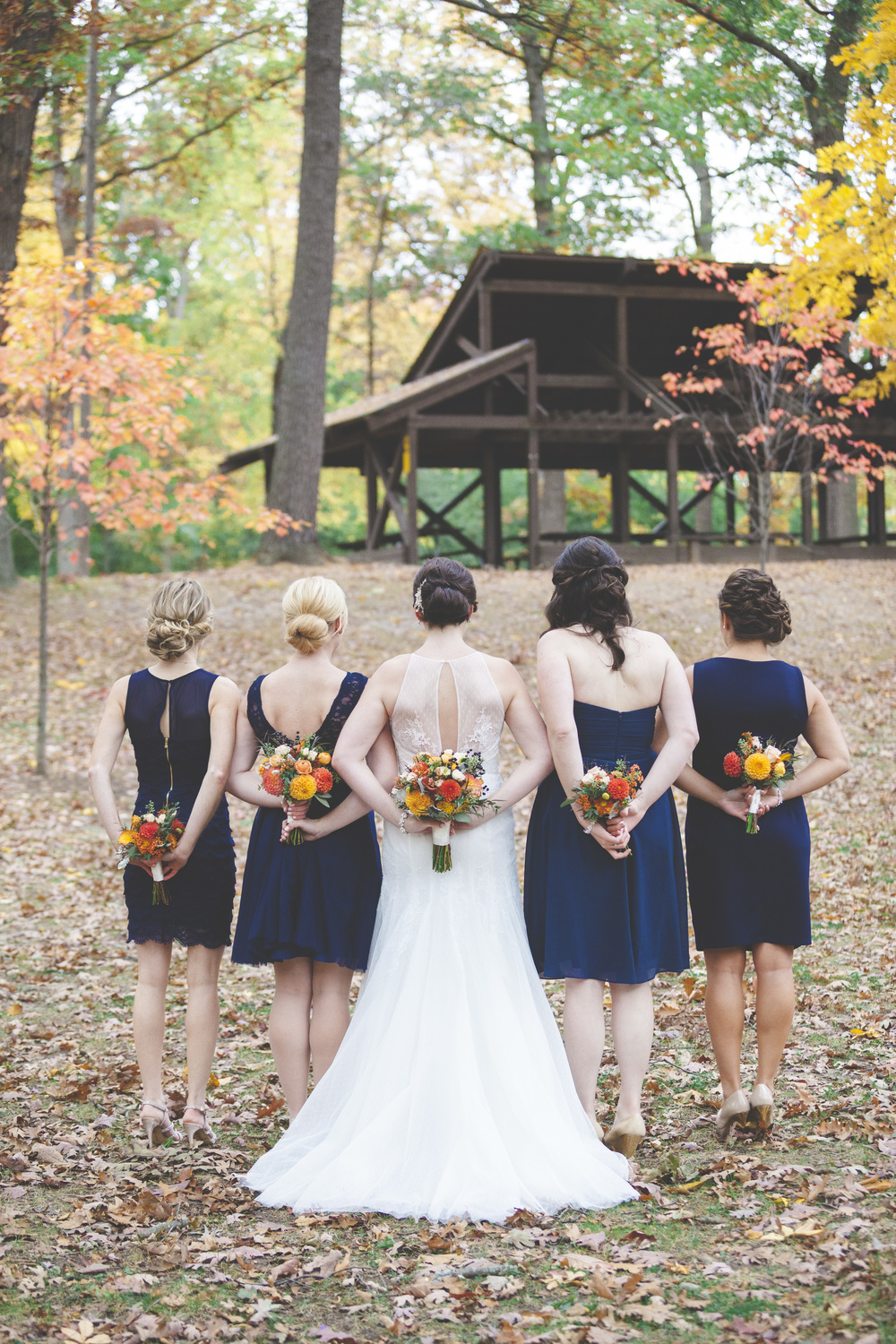 A great bridesmaids photo showing off the unique dresses.