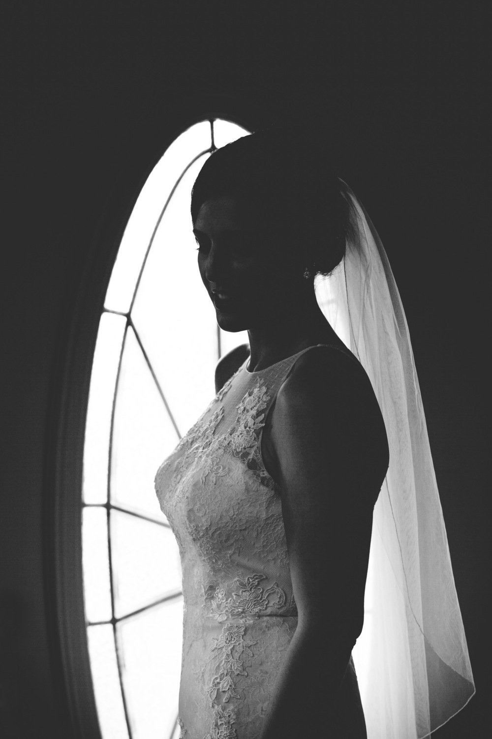 A unique silhouette shot from the window pane of the Bride's house.