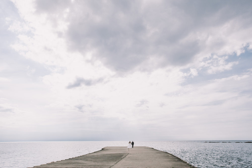 Wedding couple walking on the Kincardine pier.