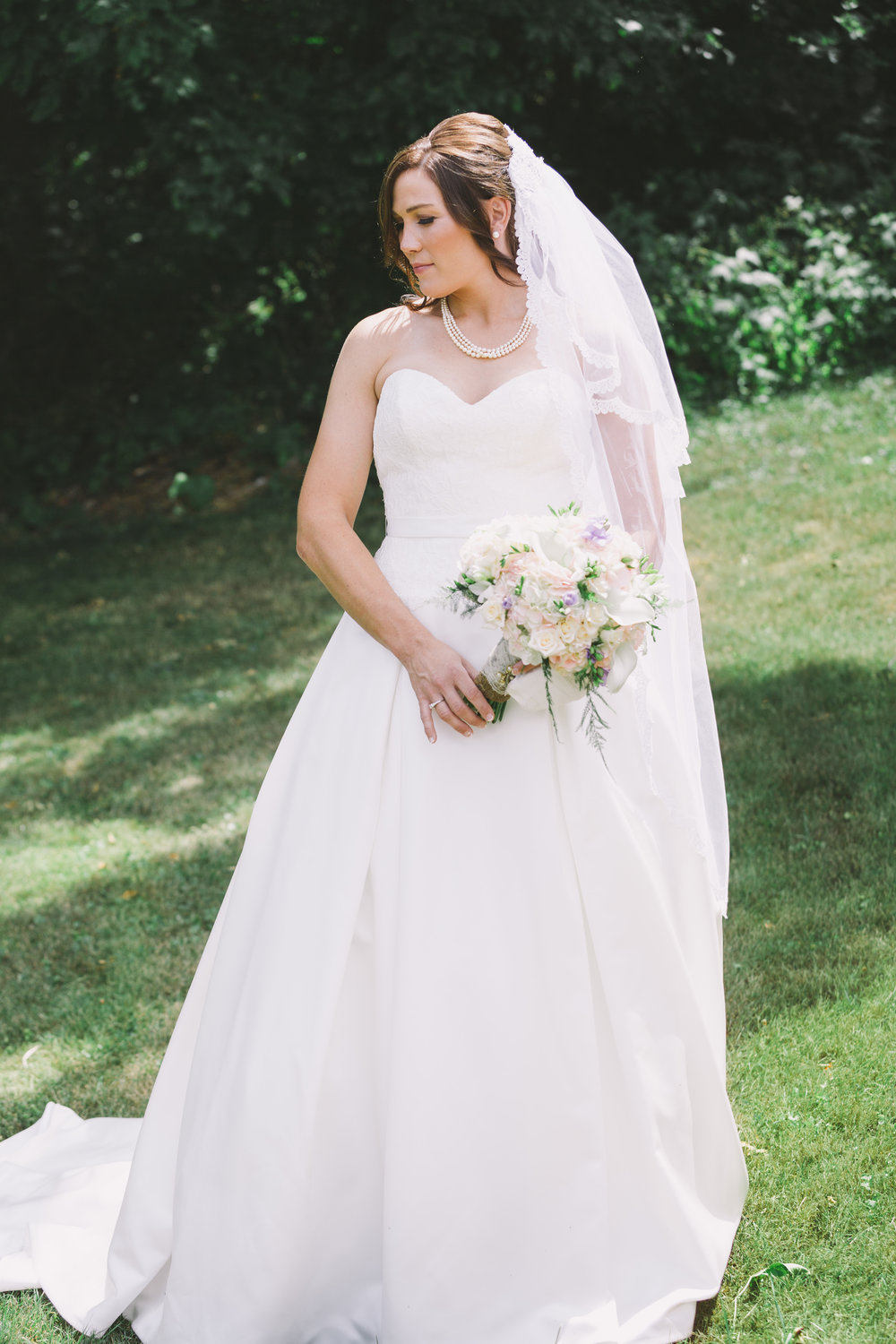 Bride in flowing wedding dress