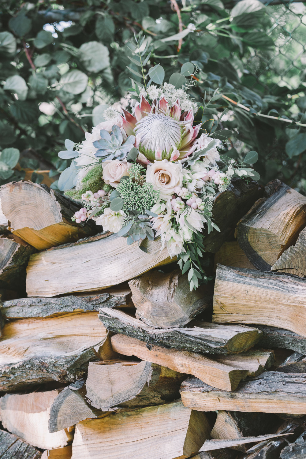 Bridal Bouquet on Wood Pile