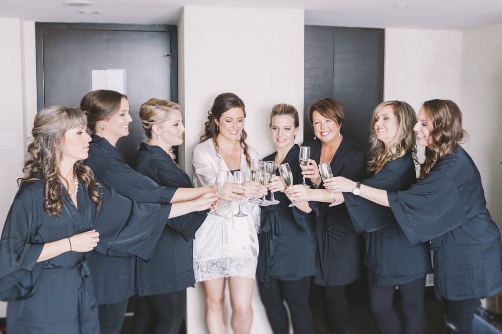 bridesmaids having a toast at a hotel