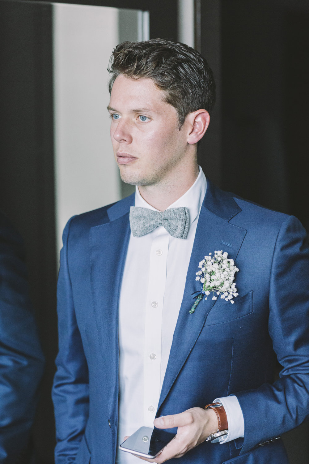 Groom with bowtie.