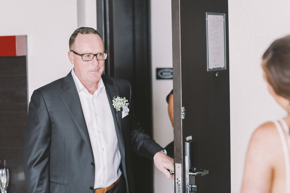 emotional father of the bride walking in the room